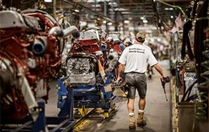 Assembler with Built Like a Mack Truck tee shirt on assembly line